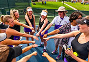 Women's tennis team showing team spirit towards