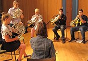 music students playing french horns for concert