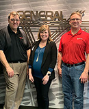 Vince Brice, Design Engineer; Jason Jerik, Plant Manager; Joel Jacobson, Director of Manufacturing; Jessica Rizza, Tom Musschoot, President; and Brian DiBona