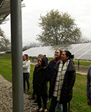 Ted Erski's Energy Resource Lab students examine a solar array